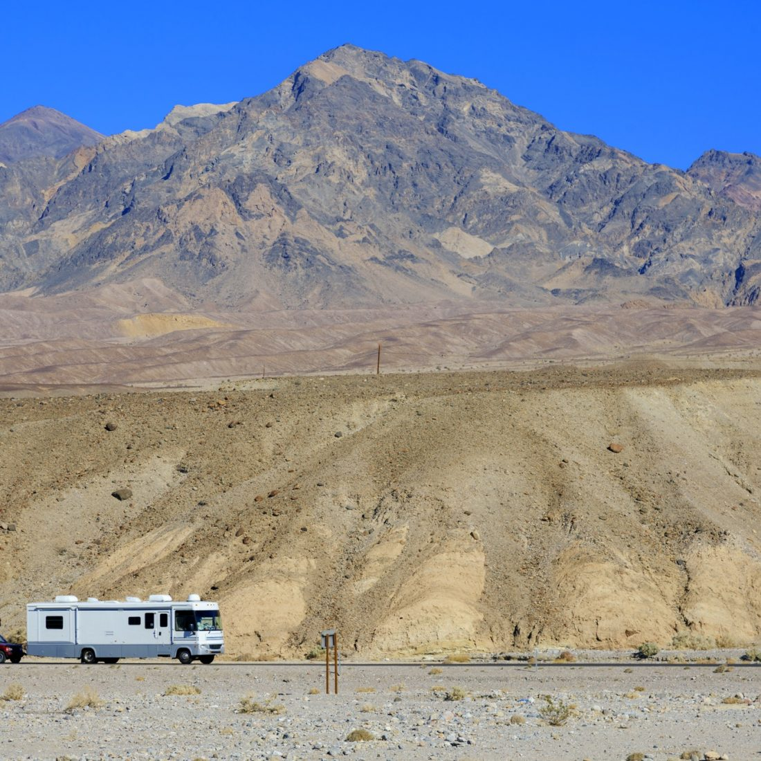 Camper taxing suv on the desert road