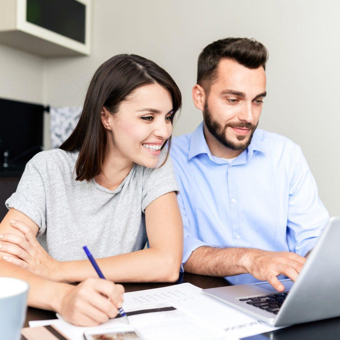 Couple filling tax return form