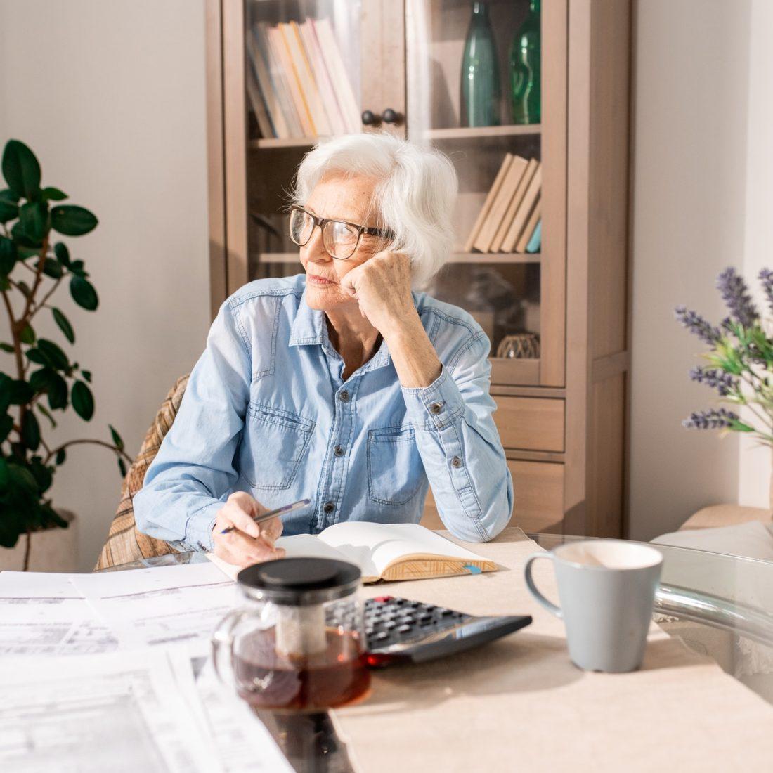 Pensive Senior Woman Counting Taxes