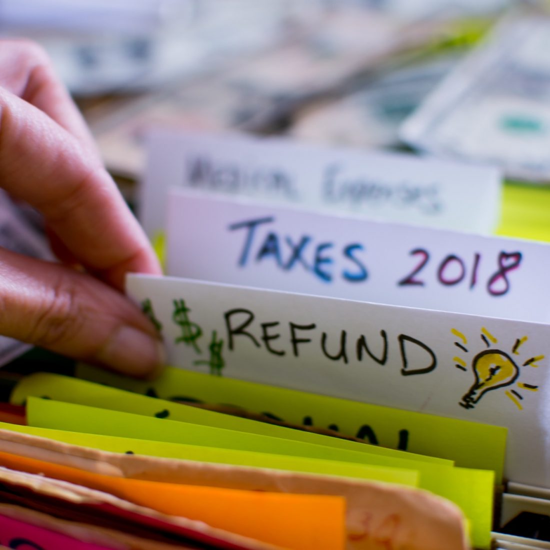 Preparing taxes 2018 tax refund ideas conceptual income tax return photography tax words and ideas